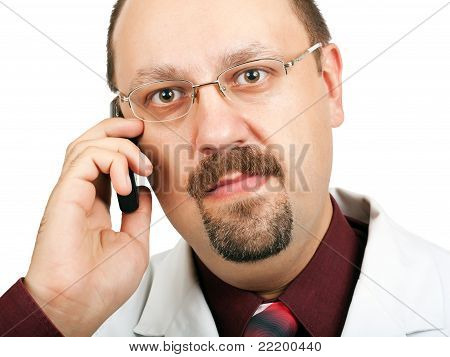 Doctor In White Coat On White Background Talking On A Cell Phone