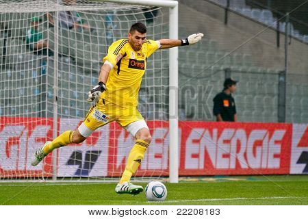 VIENNA,  AUSTRIA - JULY 26: Jan Novota  (No. 1, Rapid) kicks the ball during the friendly soccer game on July 26, 2011 in Vienna, Austria. SK Rapid wins 4:1.