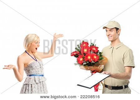 A delivery boy delivering a bunch of flowers and surprised woman isolated on white background