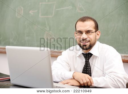 Education activities in classroom at school, Happy teacher with laptop