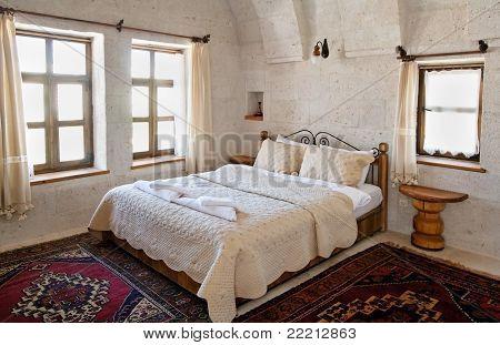 Interior Architecture White Beding Under Arches