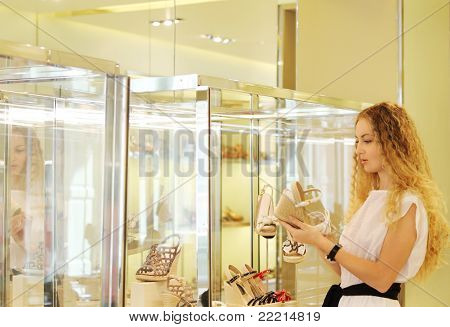 Young Woman Selecting Shoes At A Store