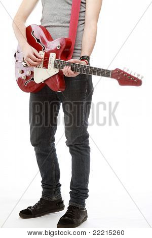 A man playing a guitar, standing isolated on white background