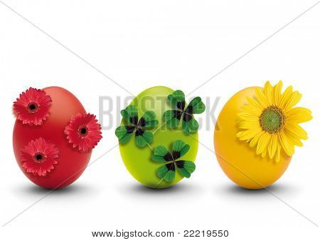 three coloured eggs with nature-decoration