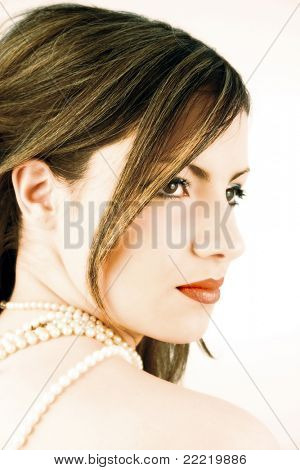 alluring woman with perls and skin like porcelain