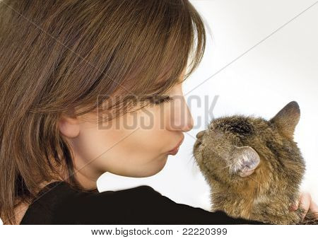 woman holding, hugging, kissing her little cat