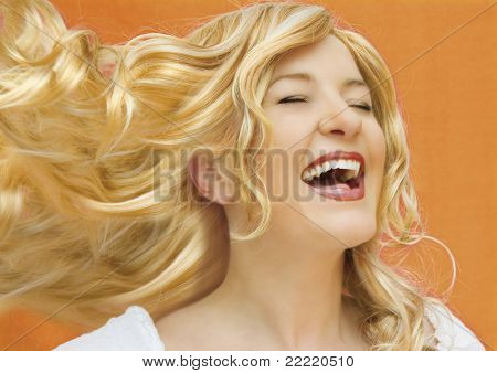 blond woman with curled hair