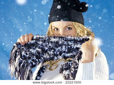 Playful blond girl is hiding behind her scarf. keyword for this collection is: snowmakers77