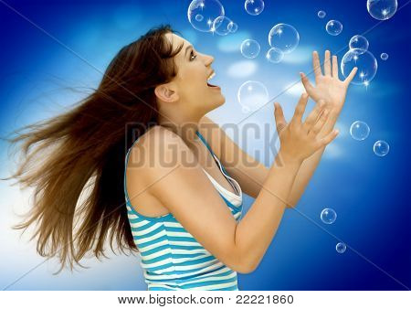 young girl with soap-bubbles. Keyword is