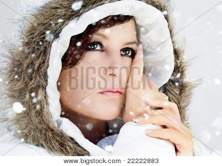 snowy fashion shot of a woman in white