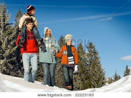 young family in winter landscape