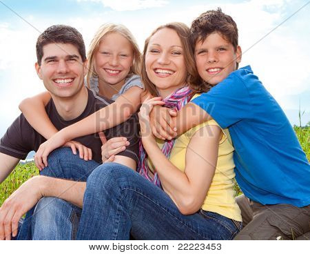 cute family having fun in the nature