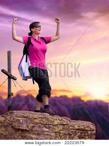 sportive woman on the top of a mountain