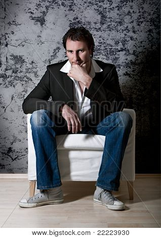 smart man sitting on an armchair