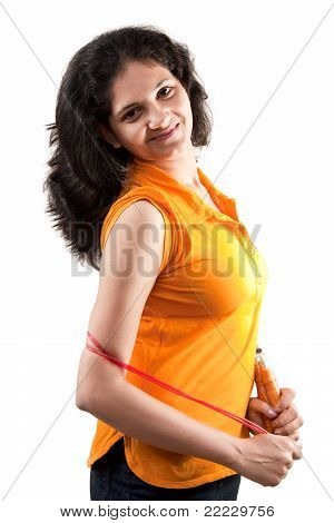 Happy Indian girl with jumping string