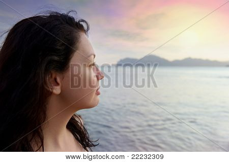 The Attractive Woman On Seacoast And Beautiful Sunset