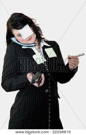 Over Worked Female Office Clerk Multi Tasking