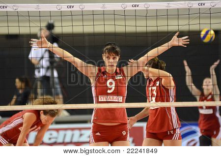 DEBRECEN, HUNGARY - JULY 8: Zsanett Miklai (in red 9) in action at a CEV European League woman's volleyball game Hungary (Red) vs Israel (Blue) on July 8, 2011 in Debrecen, Hungary.