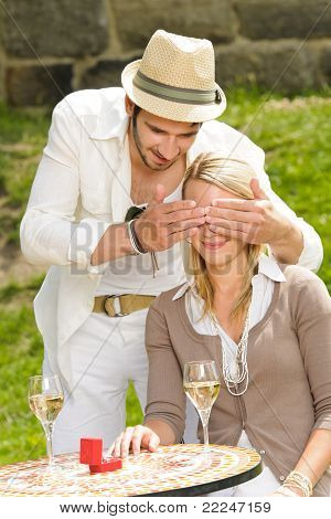 Surprised Woman Receiving Wedding Ring Sunny Terrace