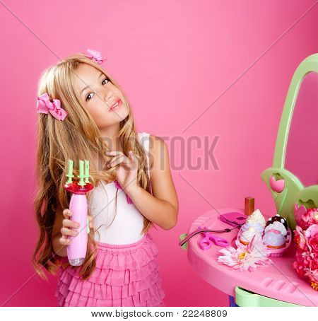 hairdresser fashion doll girl with hair curler in pink vanity