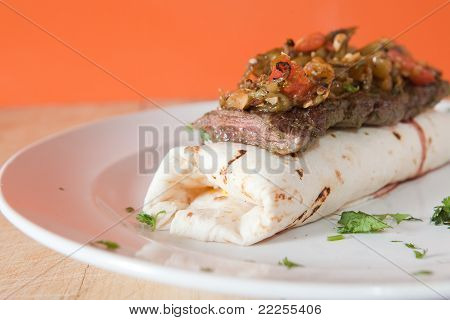 Burrito topped with steak
