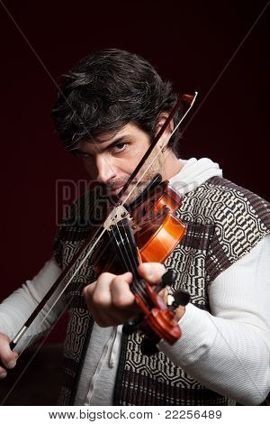 Man Plays His Violin
