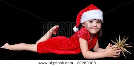 Sweet Little Girl In Santa Hat Laying On Floor With Golden Chris