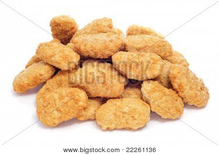 a pile of chicken nugget on a white background