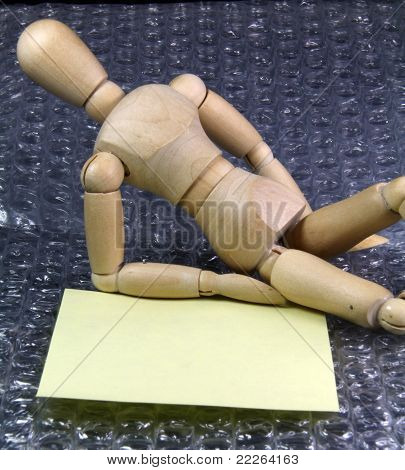 Humanoid With A Note Lying On Comfortable Plastic Bubbles