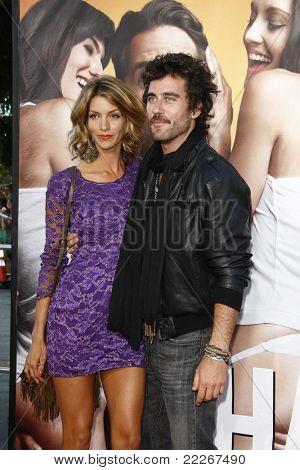 LOS ANGELES - AUG 1:  Liam McIntyre; Dawn Oliveri arriving at