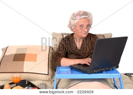 Businesswoman In Bed, Working