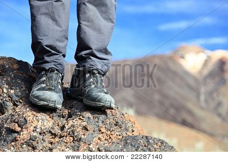 hiking boots / hiking shoes in mountain nature landscape. All year wear. Photo Tenerife, Canary Islands with mountain peak of volcano Teide in the background.