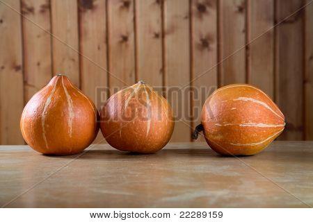 Three Pumpkins Abreast On  Table
