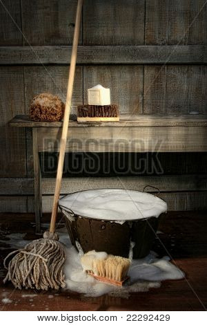Old wash bucket with mop and brushes/ Vintage look
