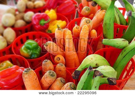Fruits and vegetables in bins at an outdoor market