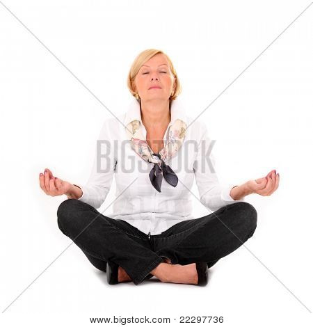 A picture of a mature woman practising yoga over white background