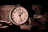 stock photo of 55-60 years old  - The picture depicts an old clock among movable types of an old printing - JPG