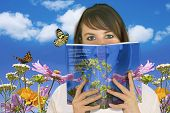 image of reading book  - Woman reading a book  - JPG