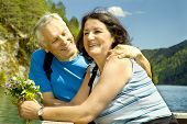 picture of old couple  - lovely mature couple beside a lake - JPG