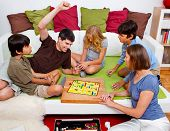 stock photo of boardgame  - a young family is playing board - JPG