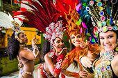 Brazilian women wearing carnival costume in an old factory poster