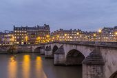 Pont Neuf in central Paris, France. The Pont Neuf is the oldest standing bridge across the river Sei poster