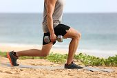 Lunge leg workout with dumbbells weights. Fitness man doing lunges training legs on beach summer out poster