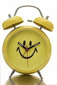 picture of happy-face  - Happy face alarm clock isolated on white background - JPG