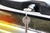 Close Up Of Key At Car Door Or Truck Door. Key Car Insert To Key Door With Copy Space. poster