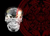 picture of day judgement  - A crystal skull shown against a backdrop of a Mayan calander - JPG