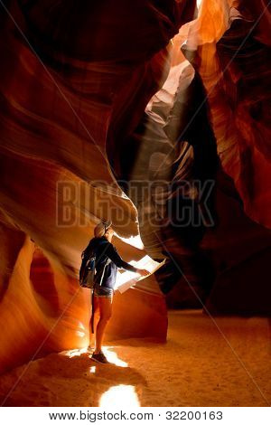 Woman exploring inside a cave at the Grand Canyon