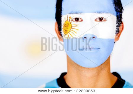 Argentinean male portrait with the flag painted on his face