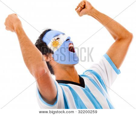 Argentinean man celebrating with arms up - isolated over a white background