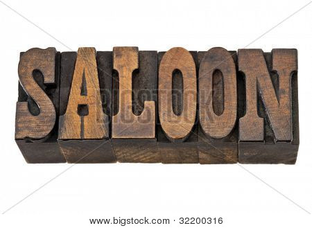 saloon  - isolated word in vintage letterpress wood type, French Clarendon font popular in western movies and memorabilia